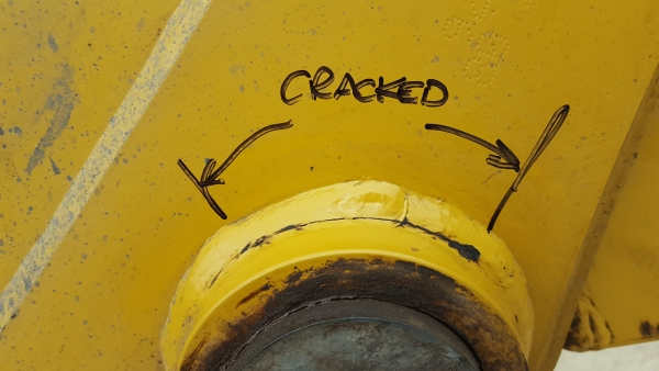 Crack propagating around welded boss on Excavator arm.